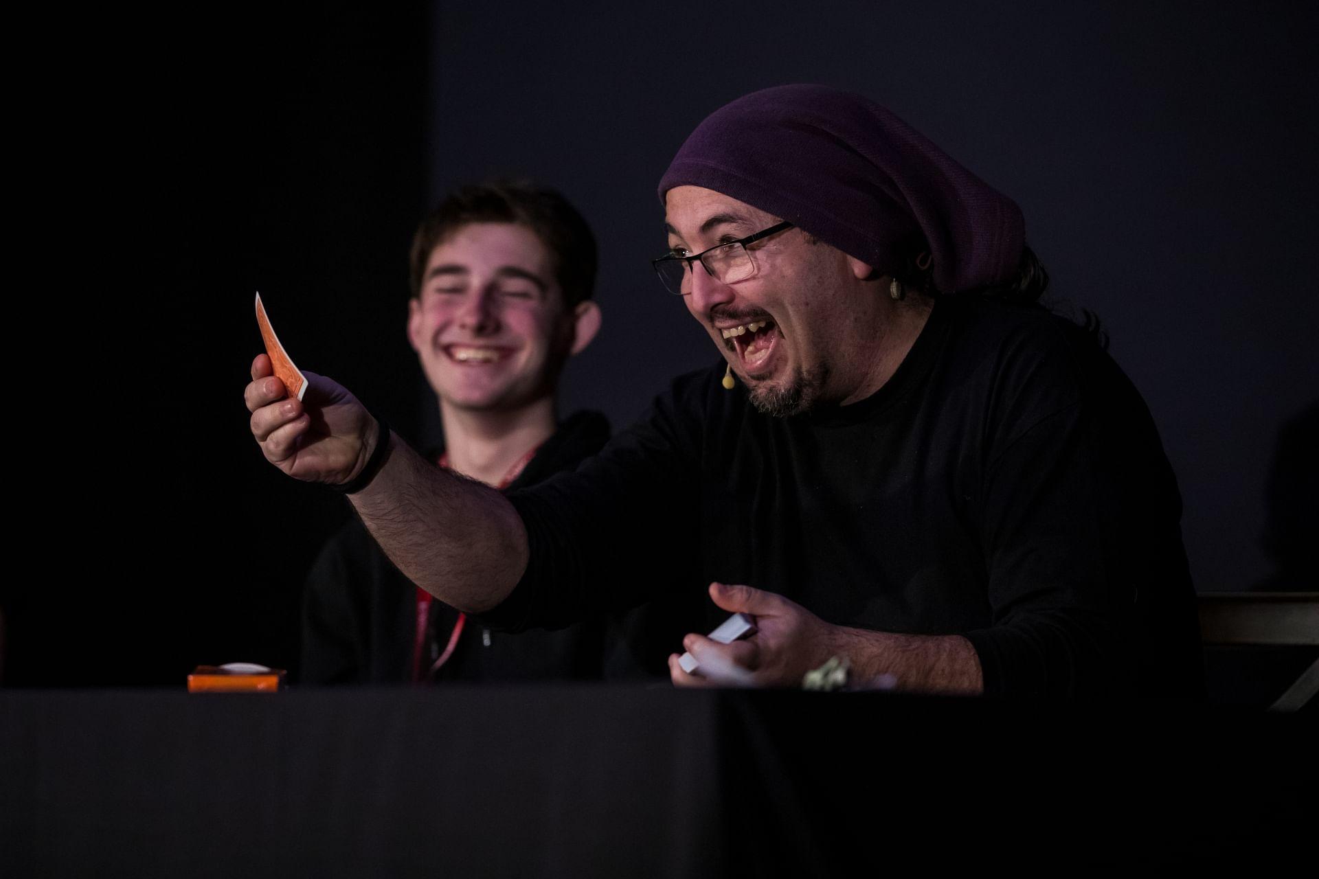 Dani DaOrtiz performs a card trick at a magic convention