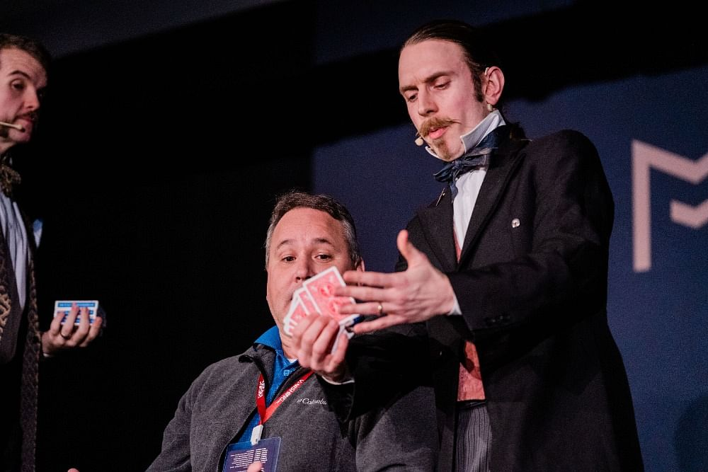 Stage magicians and mentalists Morgan & West perform a card trick at the Magifest magic convention