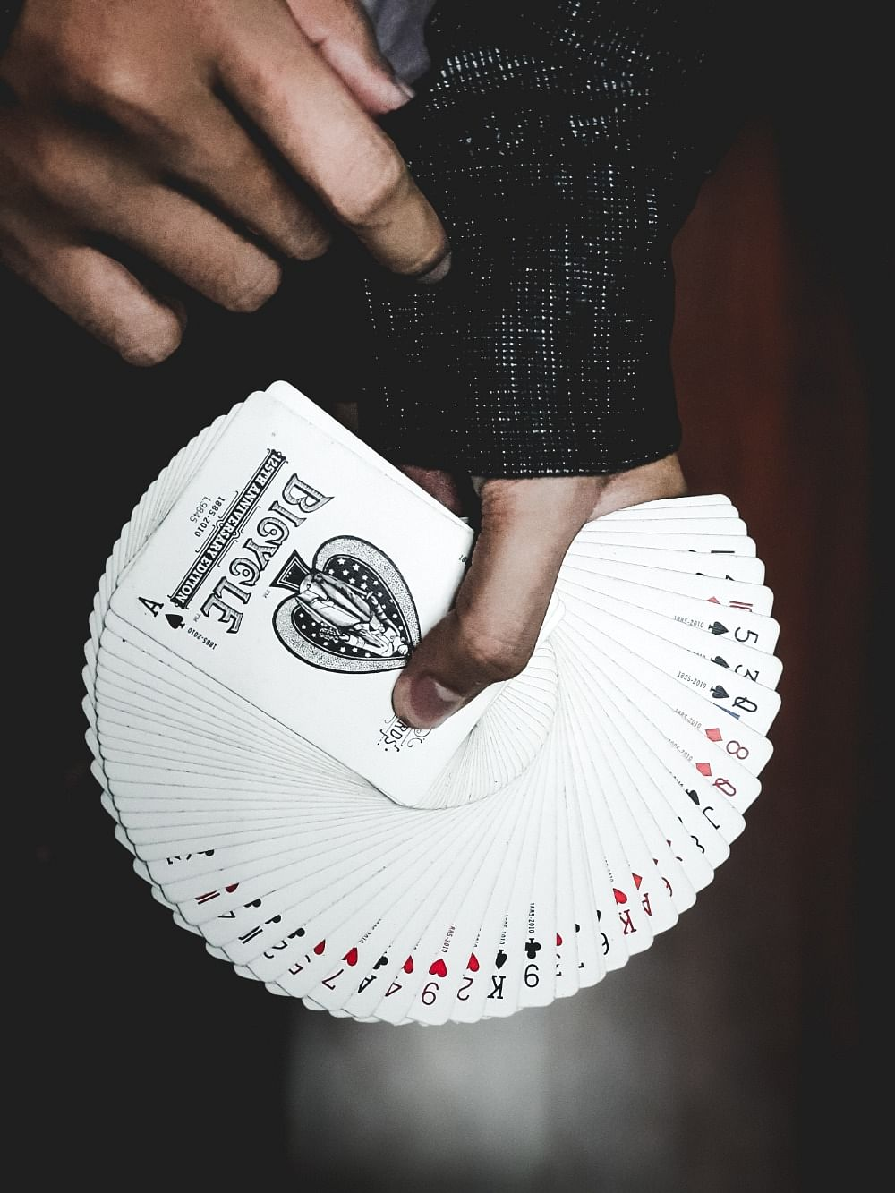 A magician fans a deck of cards in his hands