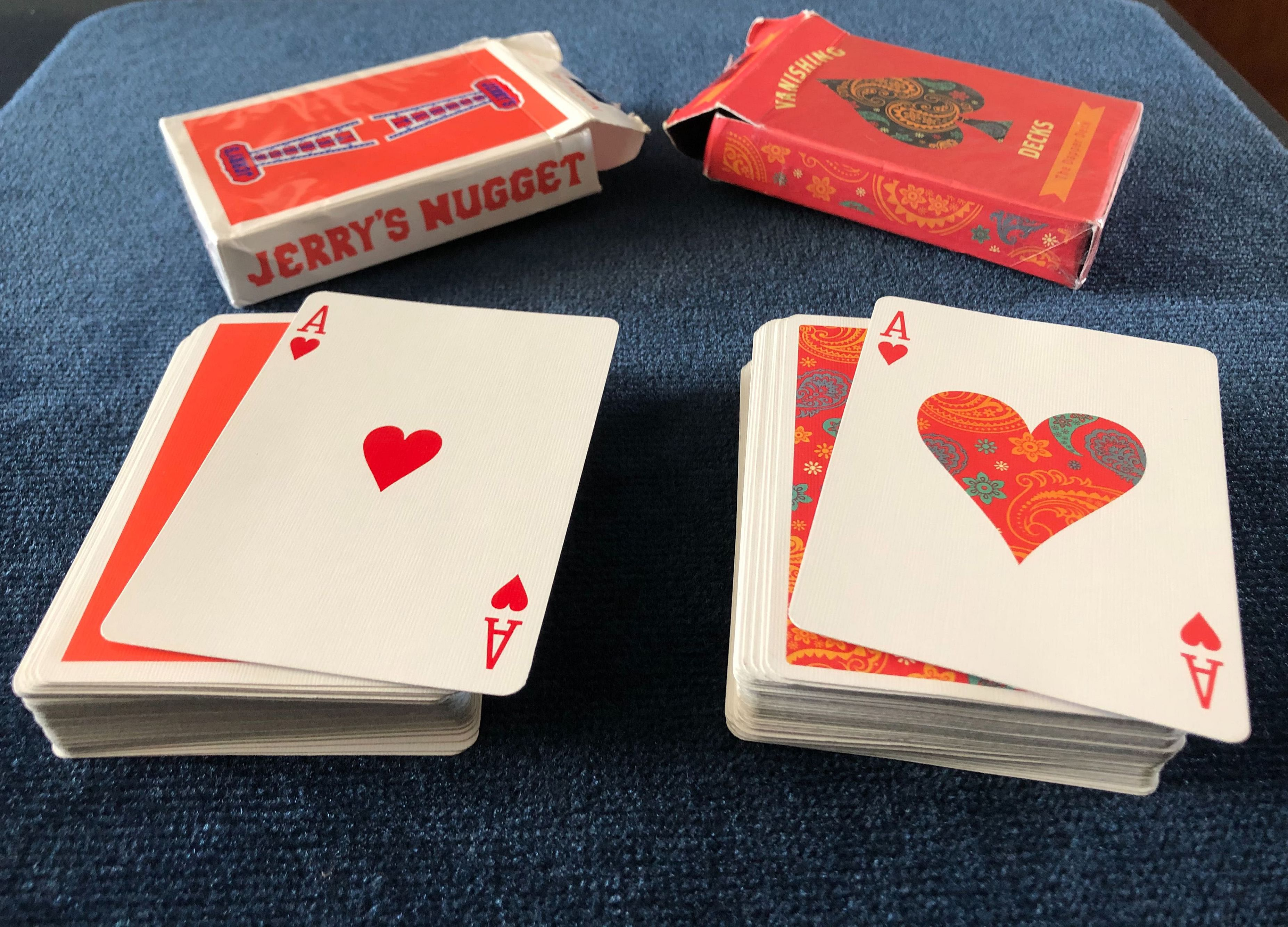 An Ace of Hearts playing card from the Dapper Deck by Vanishing Inc and an Ace of Hearts from Jerry's Nugget Playing Cards perfectly match after a performance of the beginner magic trick Do As I Do.