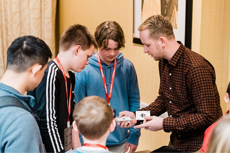 Close Up Magician Andi Gladwin teaches young magicians how to perform close up magic and card tricks with a deck of cards