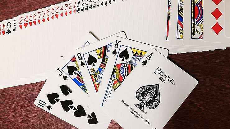 bicycle deck playing cards fanned out in a royal flush in spades