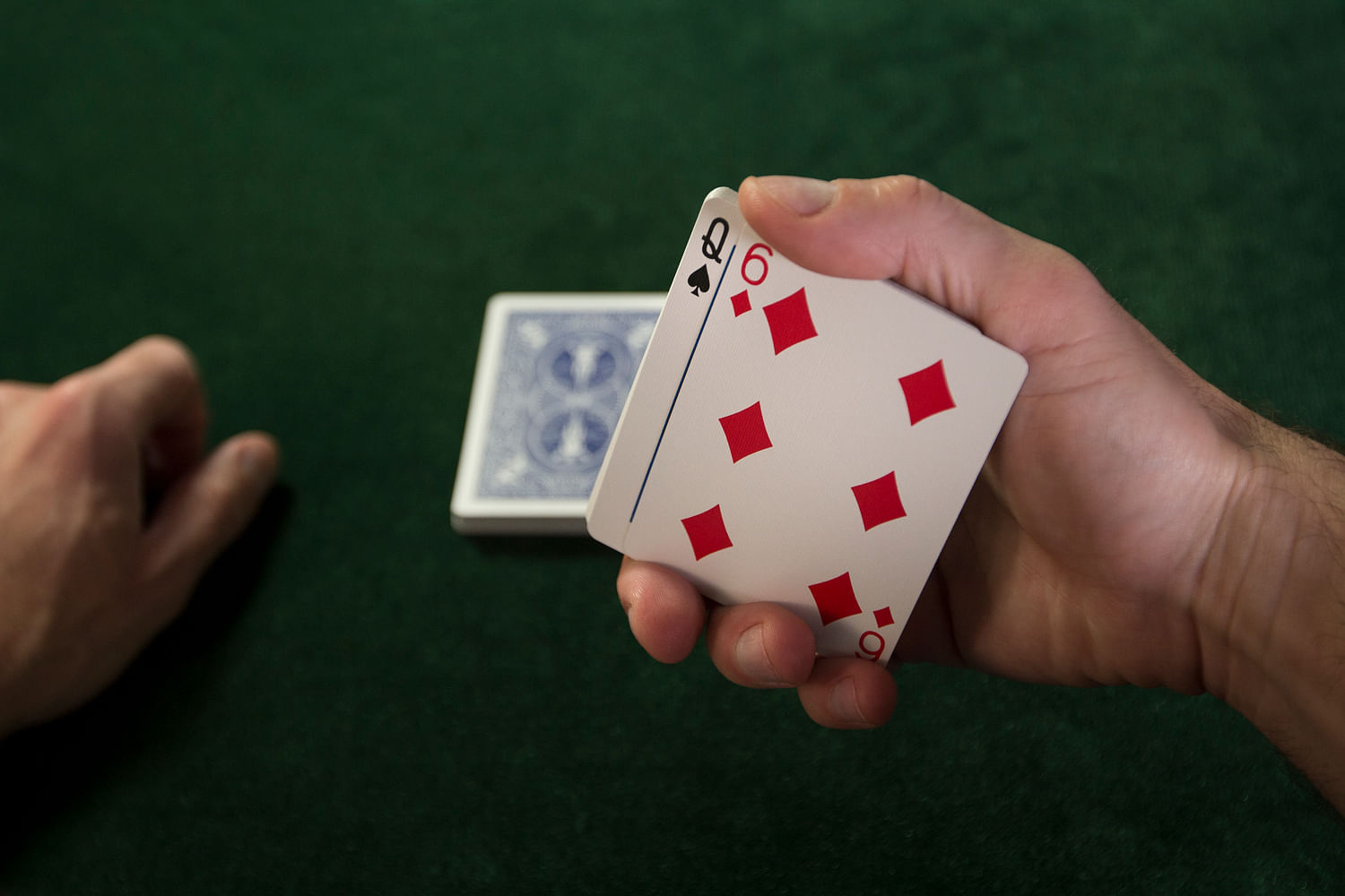 Peeking a card, a common method used by card cheats
