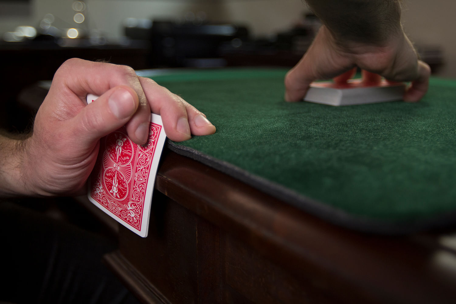 Holding out or mucking a card when cheating at a poker game