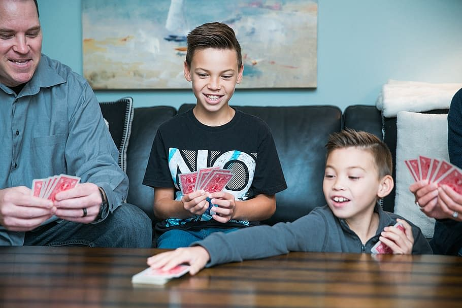 family playing cards together