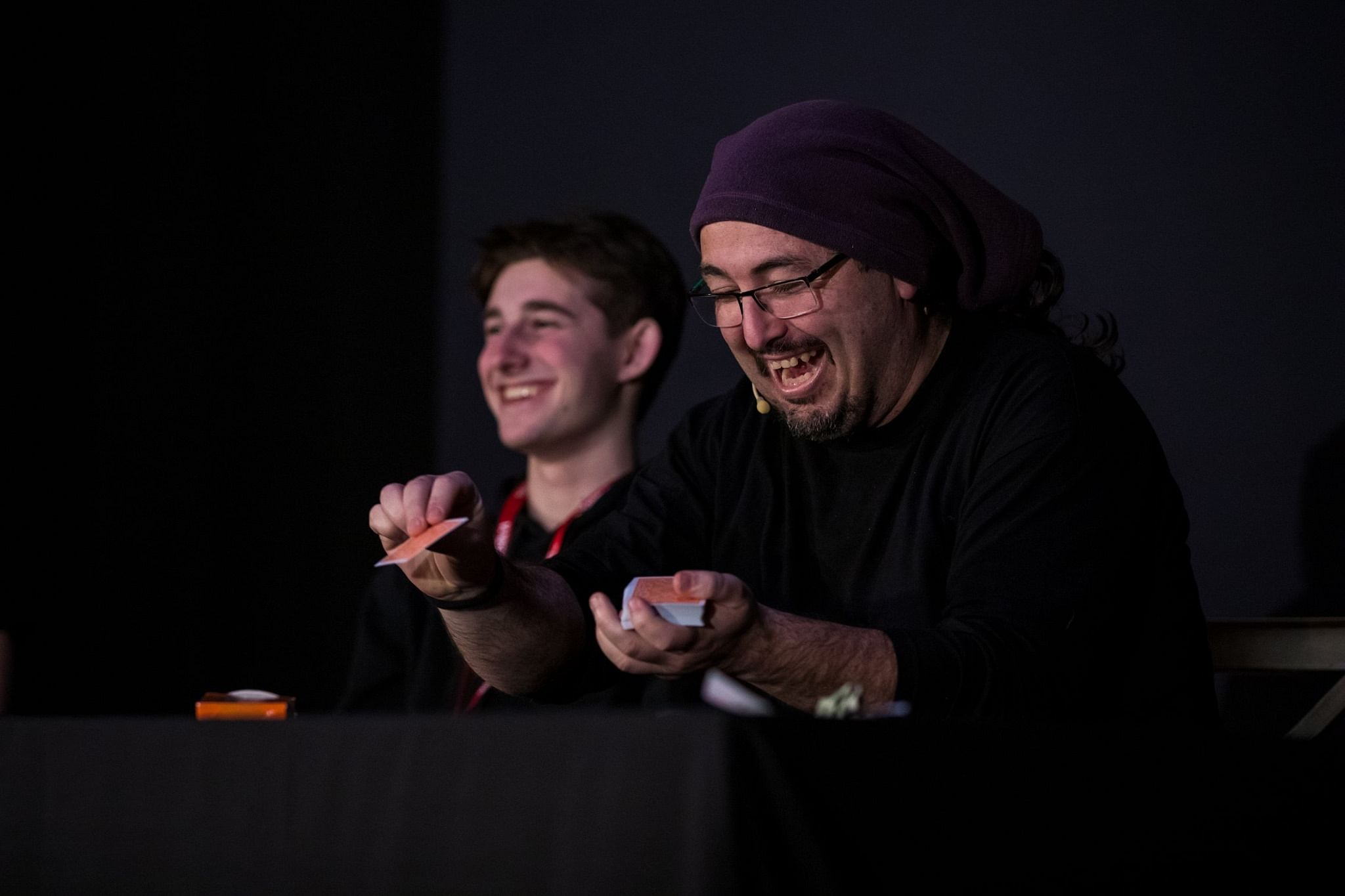 Magician Dani DaOrtiz and a spectator with huge smiles across their faces during a fun and energetic card trick
