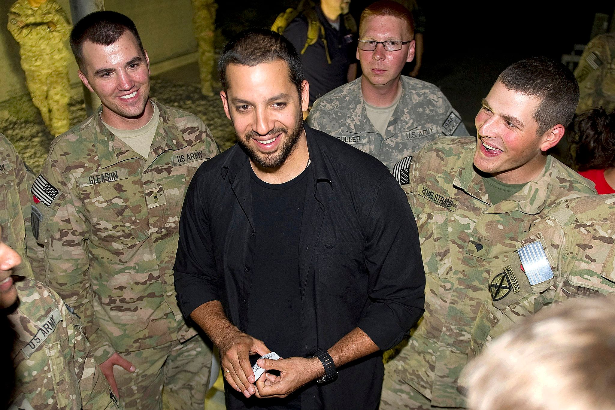 David Blaine performs street magic for members of the United States Army