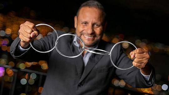 Ernesto Melero holds 4 linked chrome melero rings from vanishing Inc. magic