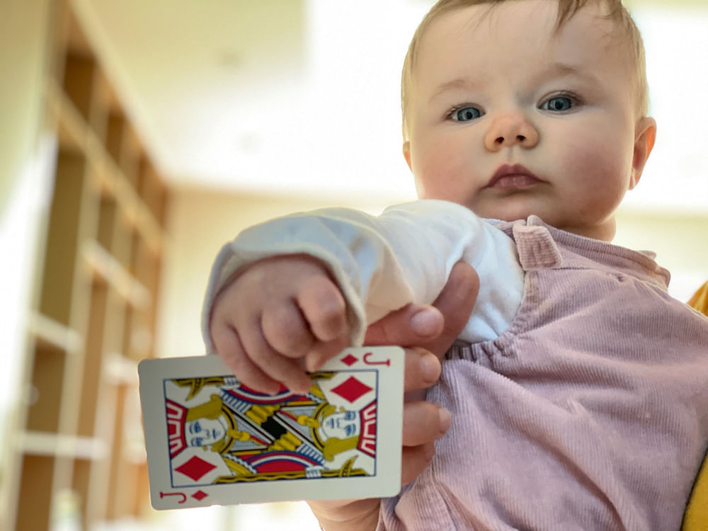 Very cute baby with a playing card