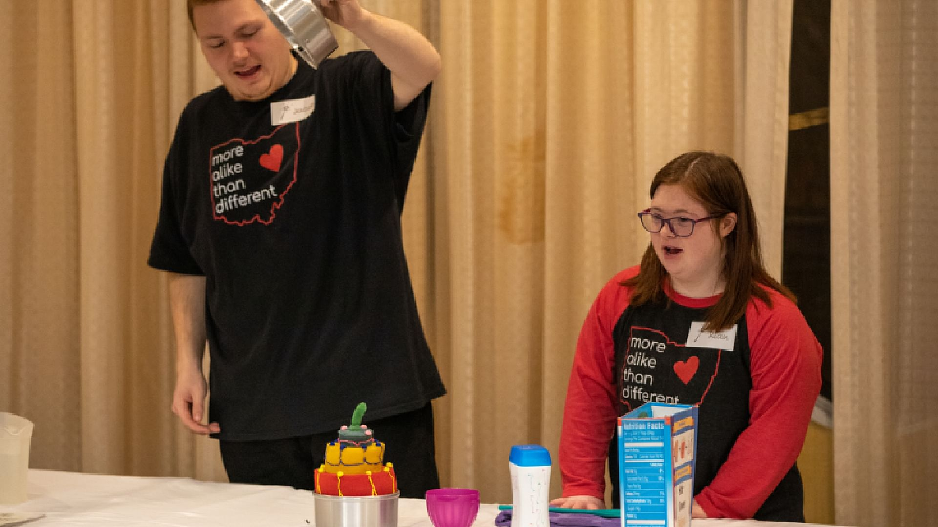 Two young kids are excited to show off an easy magic trick they learned at a magic convention