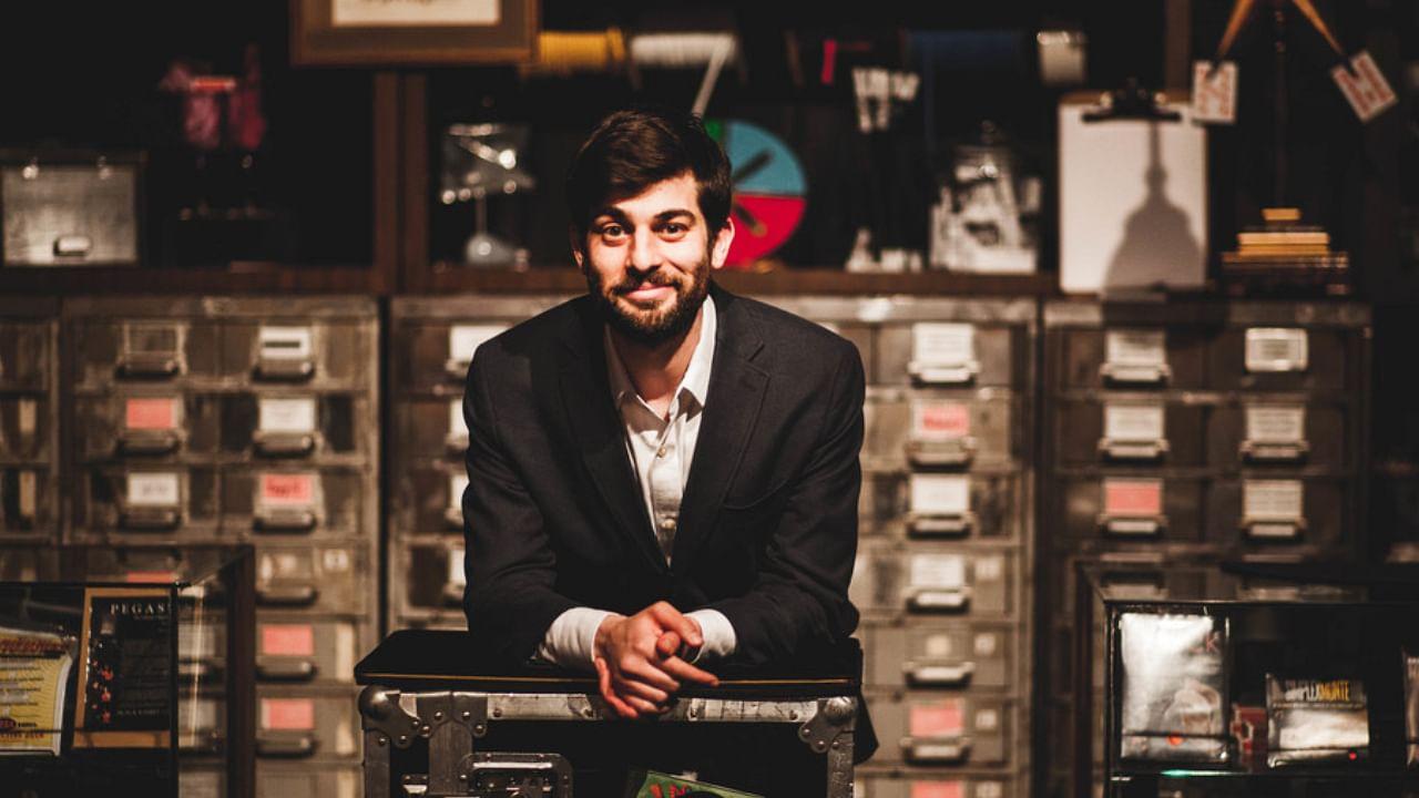 Magician Noah Levine poses in Tannen's Magic Shop before his parlor magic show magic after hours