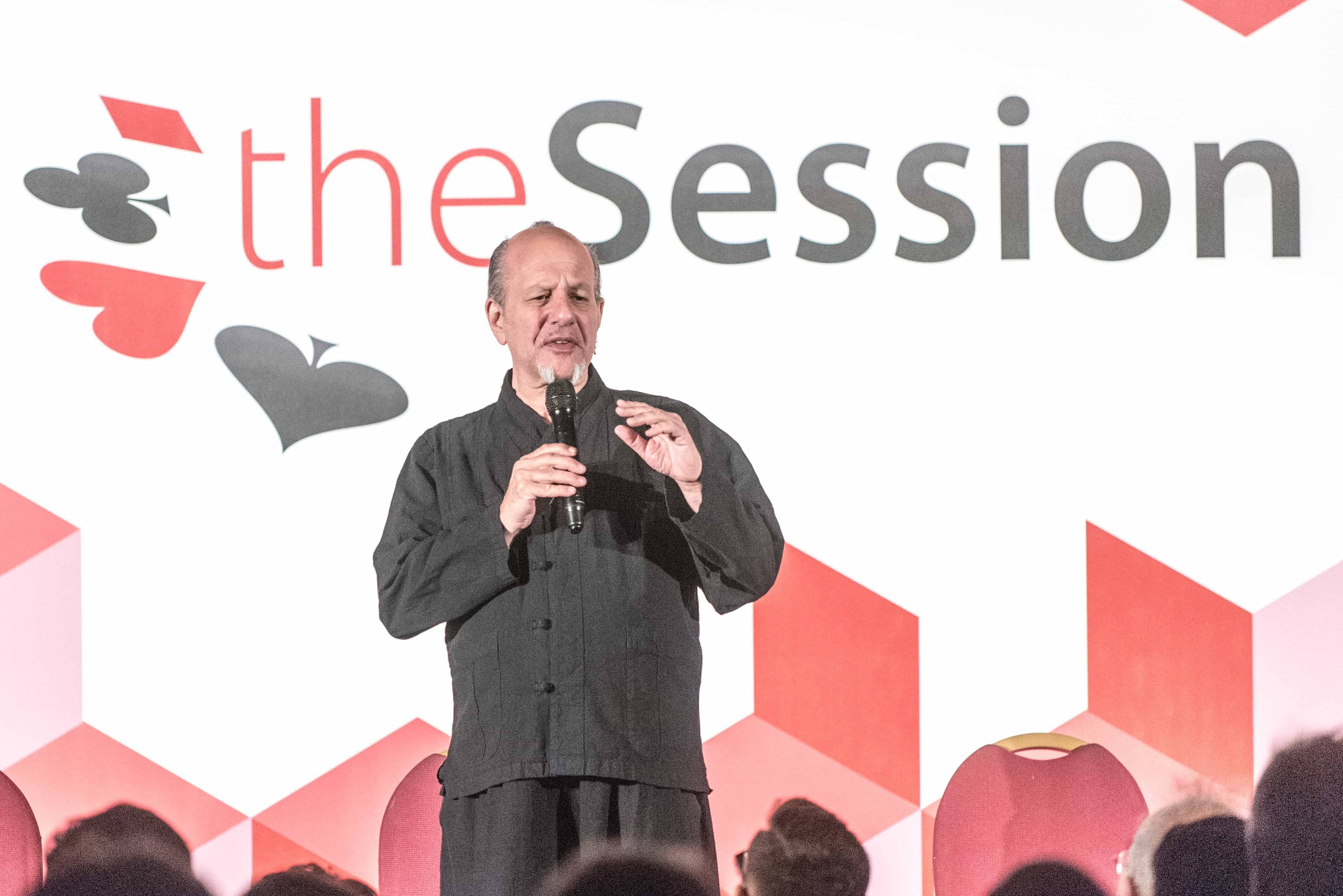 Max Maven lectures about the art of mentalism on stage at The Session