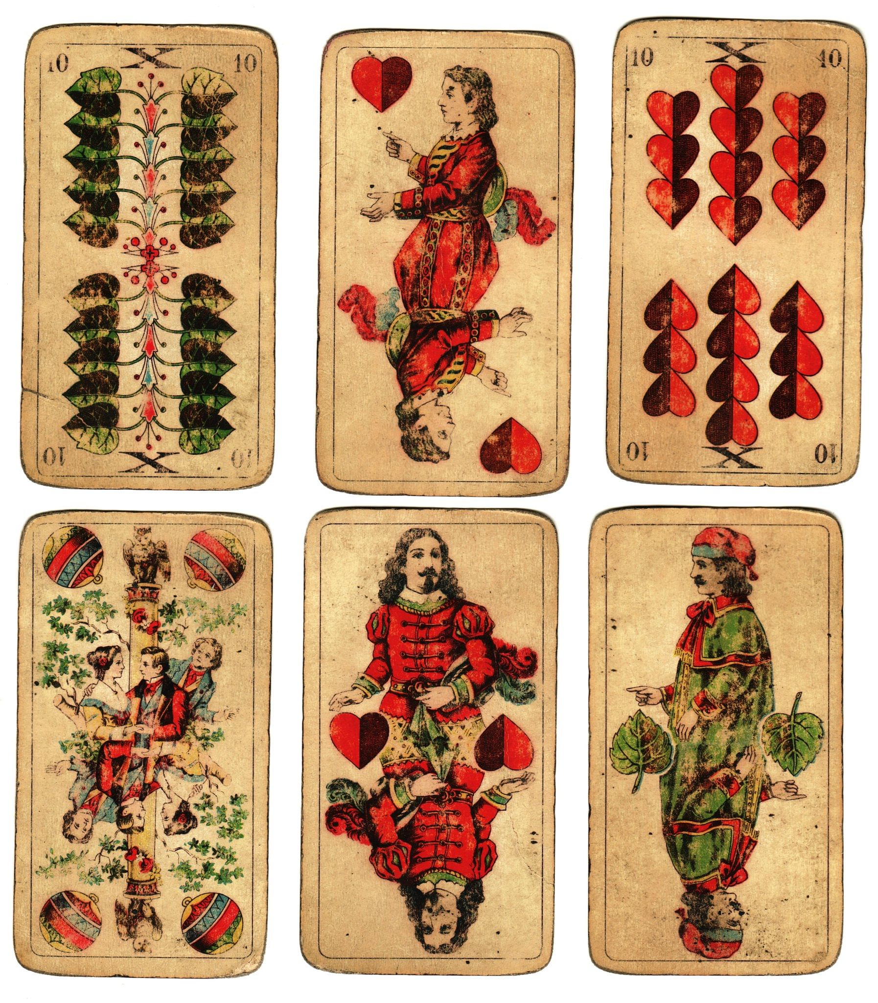old playing cards and a antique set of court cards