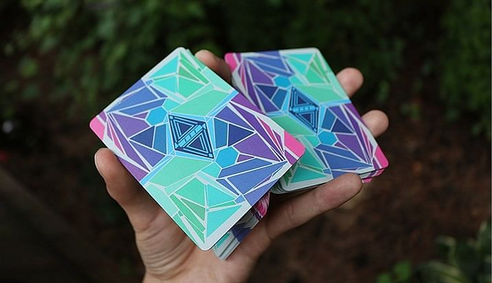 Cardistry one-handed cut with vibrant cardistry playing cards used to learn card tricks