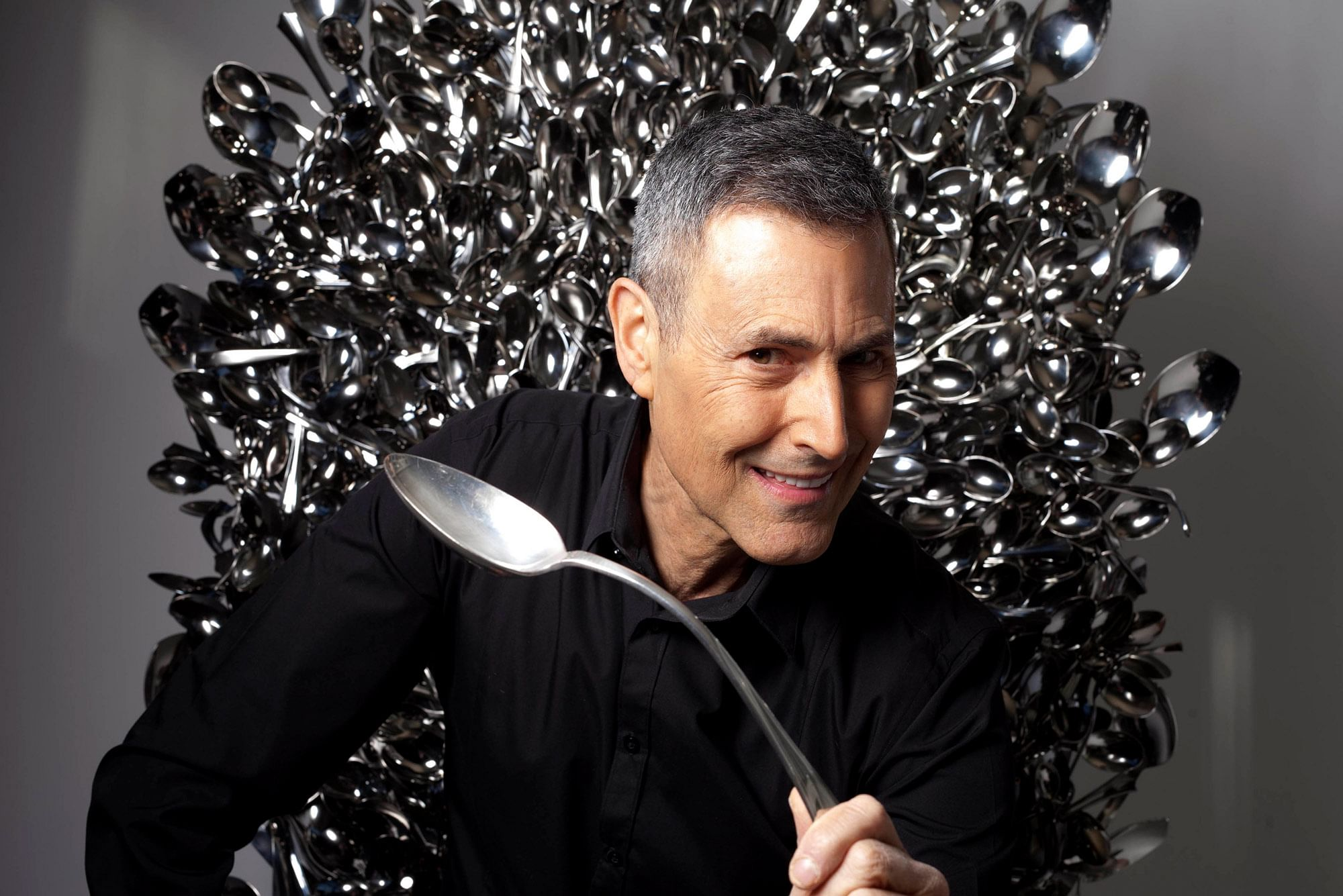 Controversial mentalist, psychic and spoon-bender Uri Geller sits on a throne of lies made of bent spoons