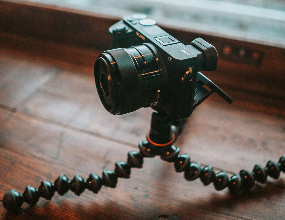 Mirrorless sony a6400 camera on tripod for zoom magic show